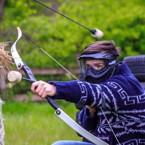 man with a bow and arrow doing archery
