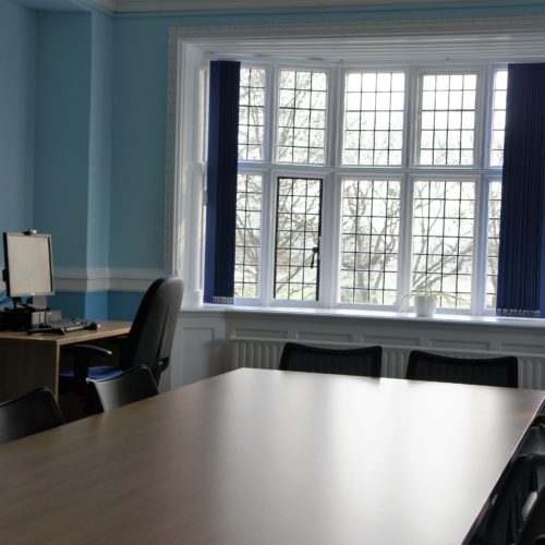 meeting room desk under window