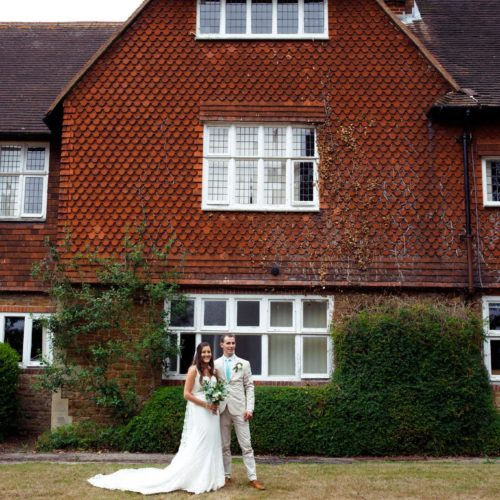 bride and groom outside merristwood college