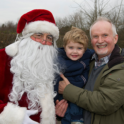 Santa with a man and his child