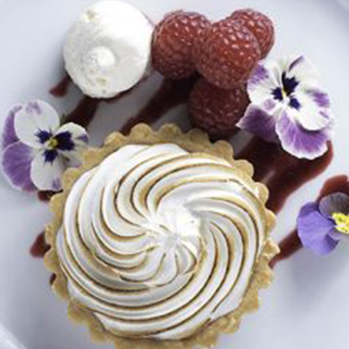 cream tart with fruit and flowers